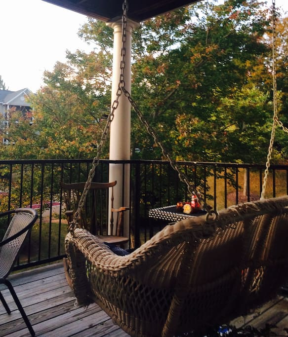 Patio area with a swing, a rocker, and a table w/chairs. Beautiful scenic view!