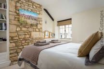 The beautiful master bedroom contains a king size bed