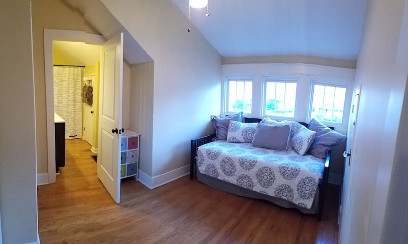 Bonus room off the living room. This walk through room is ideal for children as it can be closed off for privacy and has two twin beds.   The twin beds can be put together to make one king bed as well.