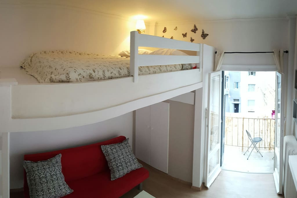 Raised bed, fresh linen and high quality matress with sofa bed underneath.