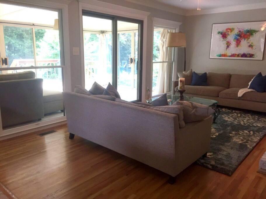 Main living area opens into the three-season sunroom. Plenty of natural light!