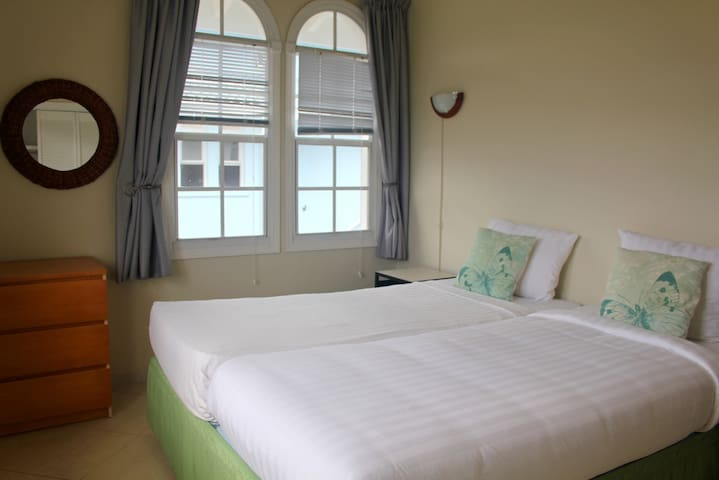The apartment has two, two person bedrooms and a single bedroom and one bathroom.