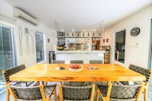 8 Seater dining table and marble topped industrial chefs kitchen