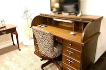 Comfortable chair and spacious desk with light and electrical outlets ready for you to catch up on your work! RokuTV, too!