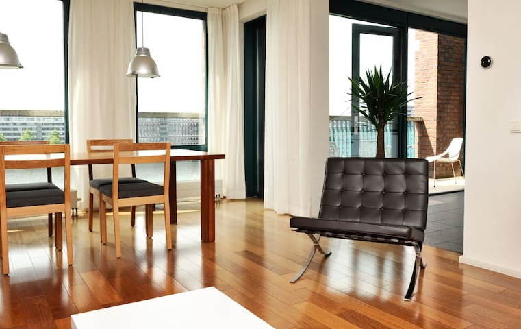 Sunny waterfront  apartment near center