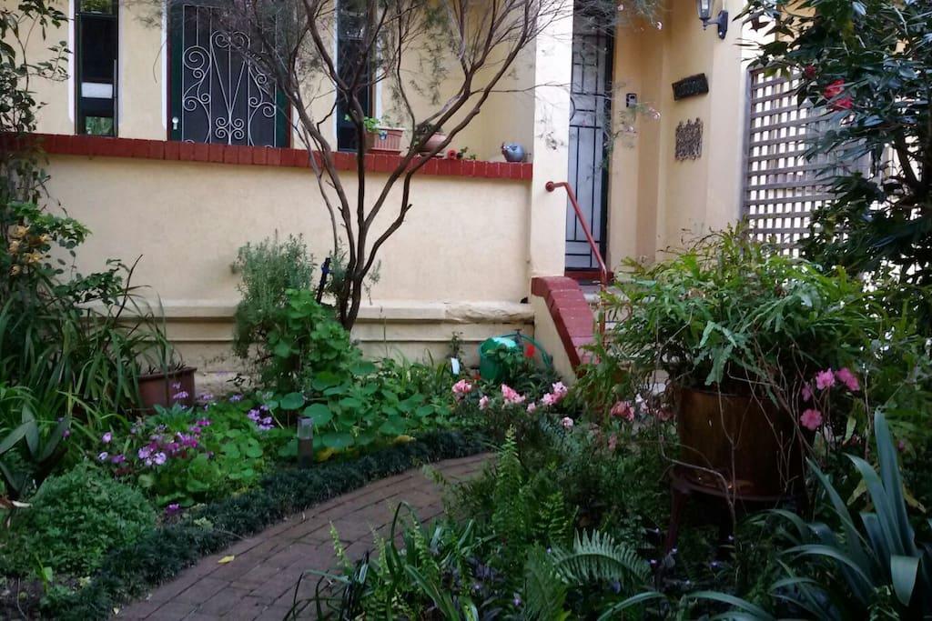 Front garden is hidden behind the picket fence.
