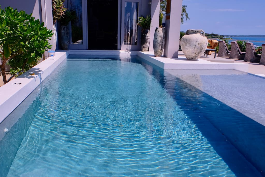Entering the swimming pool from the house.