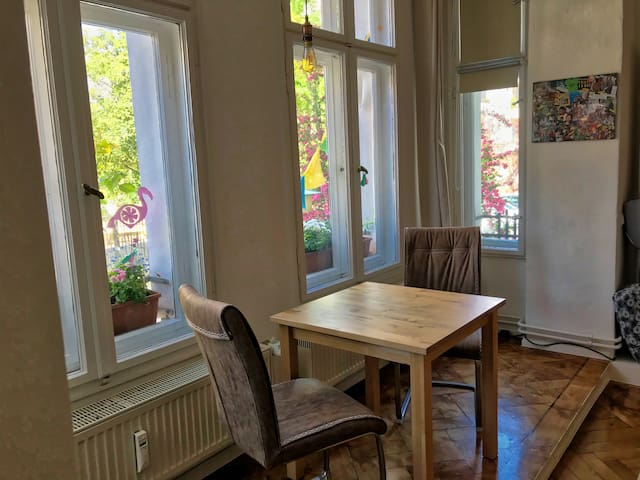 Beautiful bay windows gives a lot of light and is ideal for your dinner