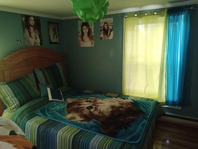 Chambre bleu aux jolis couché Soleil !