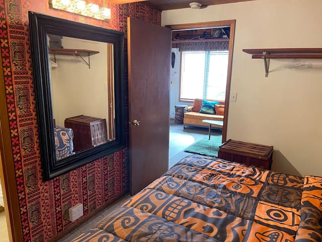 Downstairs/Master bedroom with a vintage tiki theme