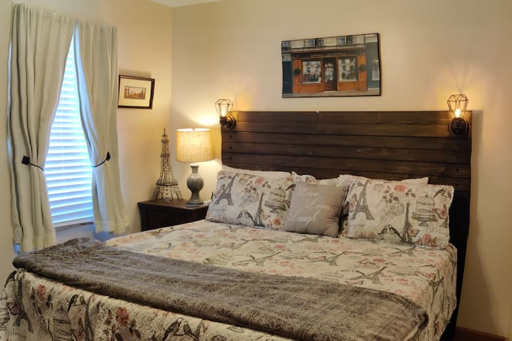 Our King sized bed w/ custom headboard w/ lights has a super comfortable mattress and several pillow options to choose from.   Light blocking curtains on the window let you control the amount of light in the room, no matter when you prefer to sleep.