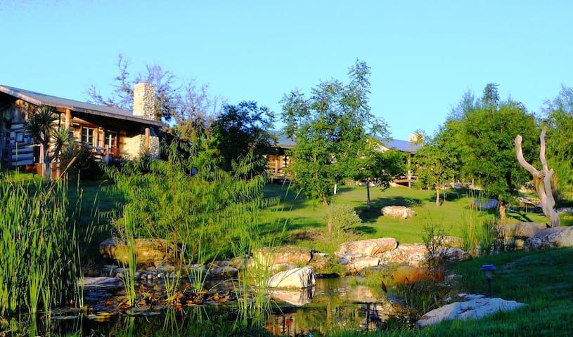 Swiss Village alongside flowing creek in The Texas Hill Country