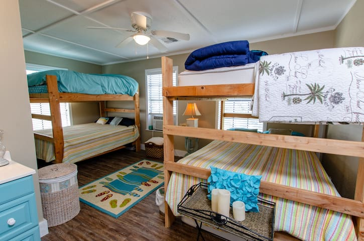 Upstairs Bunk Room room with 4 full size mattresses and private bathroom