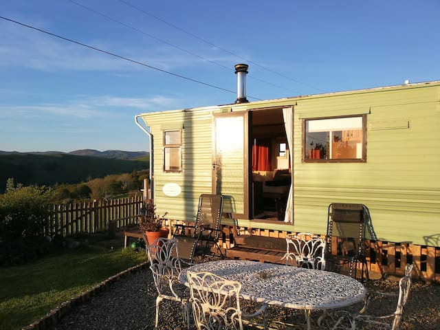 Cozy satic caravan with a log burner for couples.
