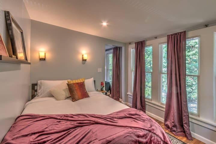 the windows bring a ton of  natural light but just clothes the blinds and shut the curtains when you want to catch some shut eye