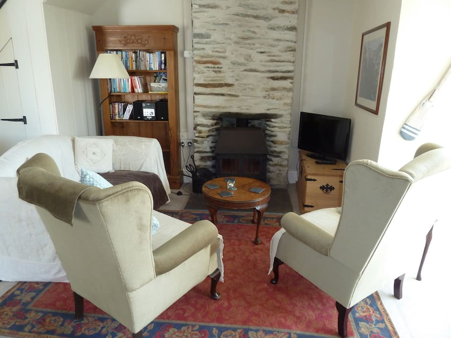 The open plan living room with log burner.