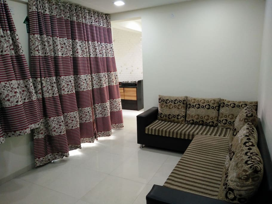 Living Room with designer sofas and curtains