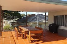 65m2 deck with ocean views and 14 pax table