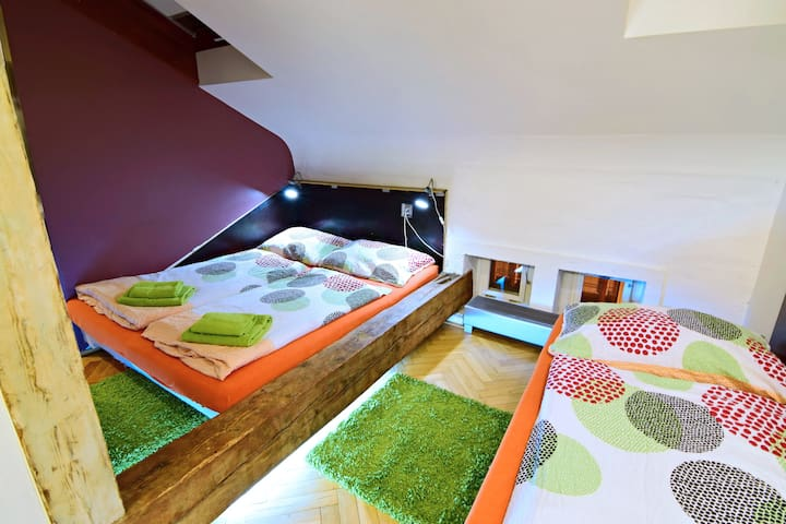Bedroom with double bed, one single bed connected with bathroom and changing room