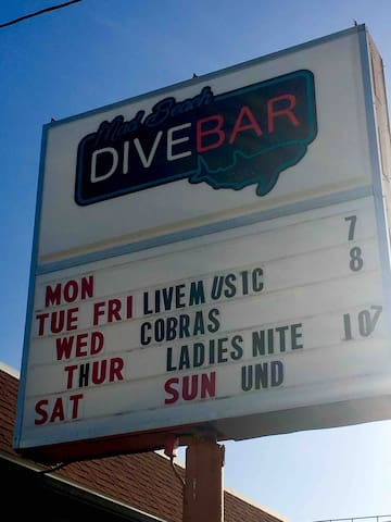 Another walkable watering hole is the Dive Bar.  Laid back place with live music many nights of the week.  No need to drive, it's literally a few minute walk.  Pretty decent food too!