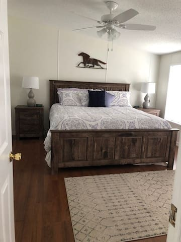 The master bedroom with a plush, king size bed!
