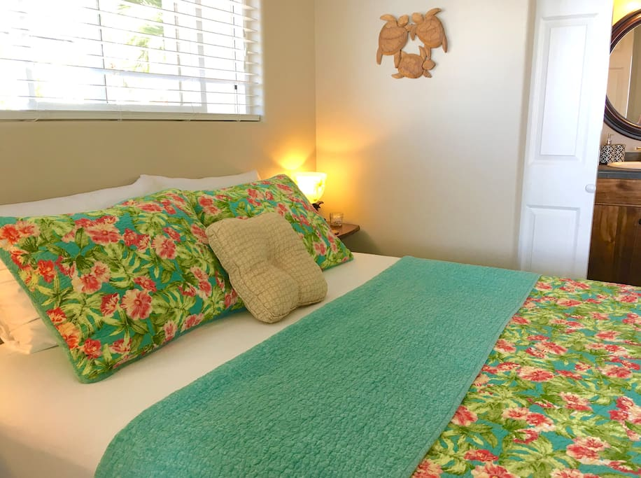 """SUITE 1.  Clean, Fresh, Island inspired Tommy Bahama bedding, on the guest quoted, """"very comfy"""" Queen bed  :)"""