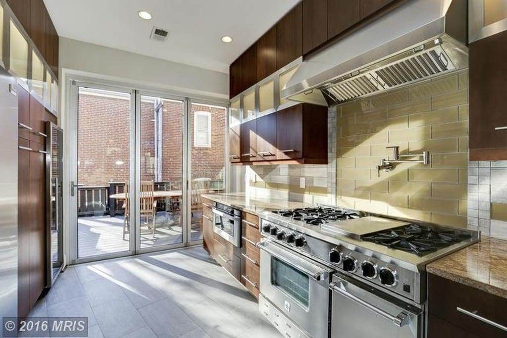 Lots of natural light in the gourmet kitchen with 3 glass doors that slide open to enjoy the backyard patio