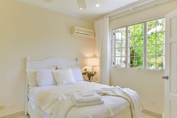 The second bedroom features an attached bathroom and a full-sized bed. Each bedroom offers air-conditioning for your sleeping comfort.