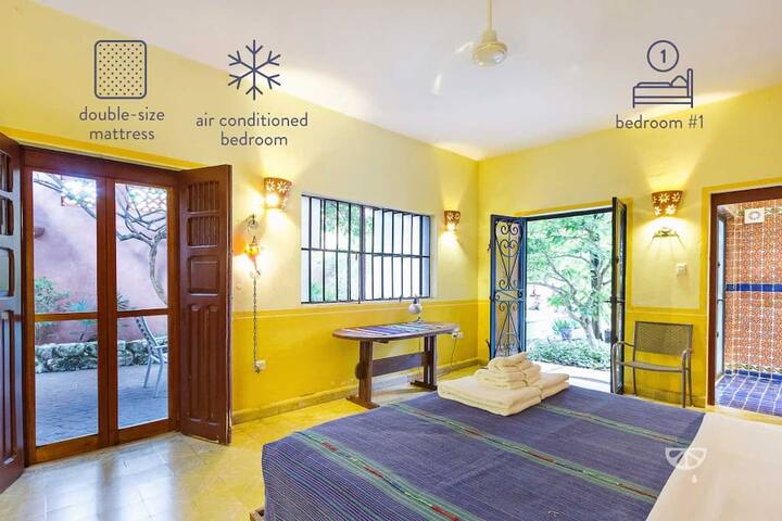 Rear bedroom with doors to patio and garden