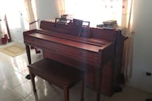 Piano at one end of living room