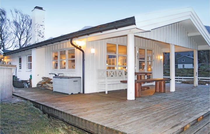 Awesome home in Rugsund with Sauna and 4 Bedrooms