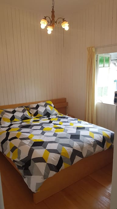 Queen size bed with brand new, super comfy mattress. All new linen.