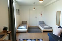 The main living space with two separate beds and a sofa bed that fits two.