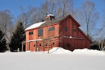 The Barn in winter offers a cozy homecoming after a day in the snow.