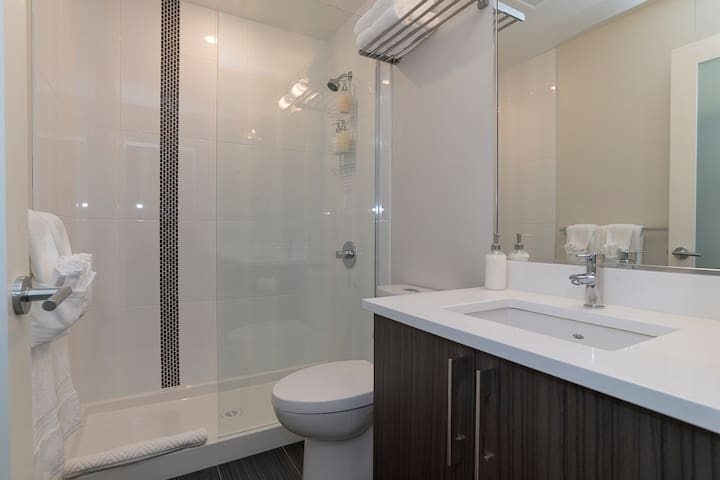Shiny designer Bathroom with heated floors, laundry, and amenities