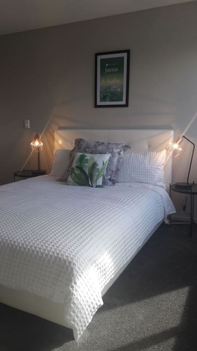 Sunny, spacious bedroom with very comfortable bed and modern furnishings