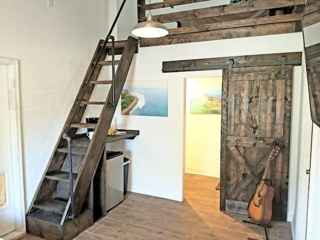 Rustic barnwood doors, railings and stairs
