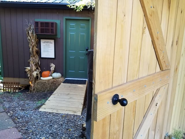 Street side gate to cabin entrance with barn door gate.