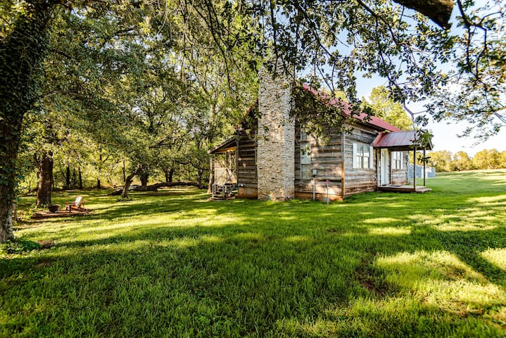 Cabin nestled among trees, just out of OKC