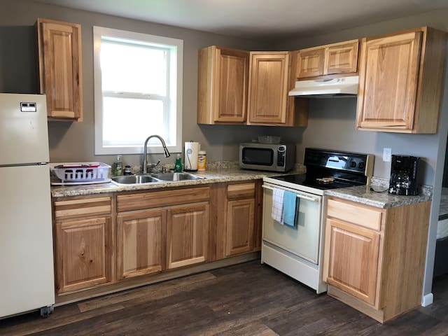 Full kitchen, including stove, microwave, refrigerator