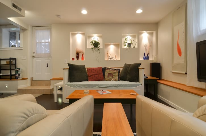 View of open concept living space from dining room table