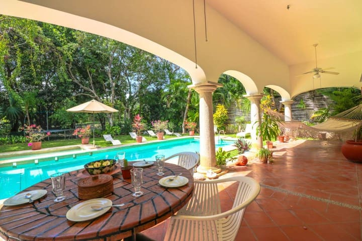 Outside dining and hammock poolside, with fans and lighting!