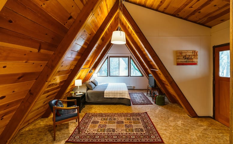 Upstairs loft has a king sized bed.