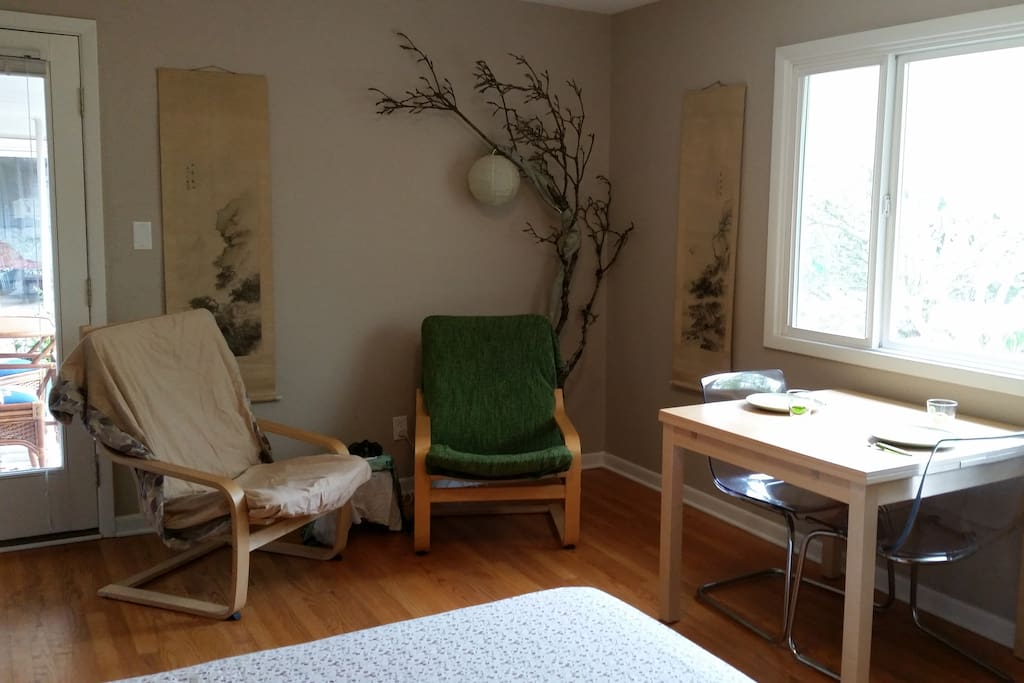Indoor sitting area.  The door on the left is your separate entry into the Airbnb.  The table folds out to a larger surface for feasting, working, or doing a jigsaw puzzle.