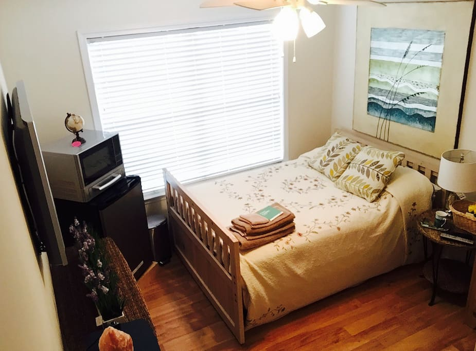 Queen hand crafted bed and a full futon sliding mattress underneath shown in other pictures.