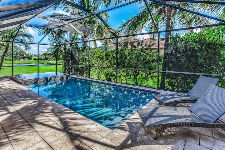 Lagoon-front home w/ private saltwater pool, spa & shaded lanai - 1 dog OK!