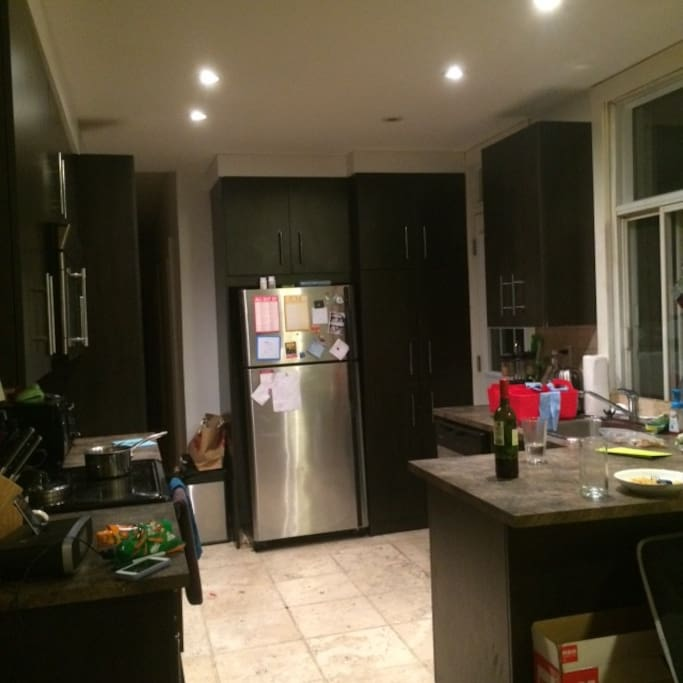 Kitchen, stocked with pots, pans, utensils, etc. Also washer and dryer
