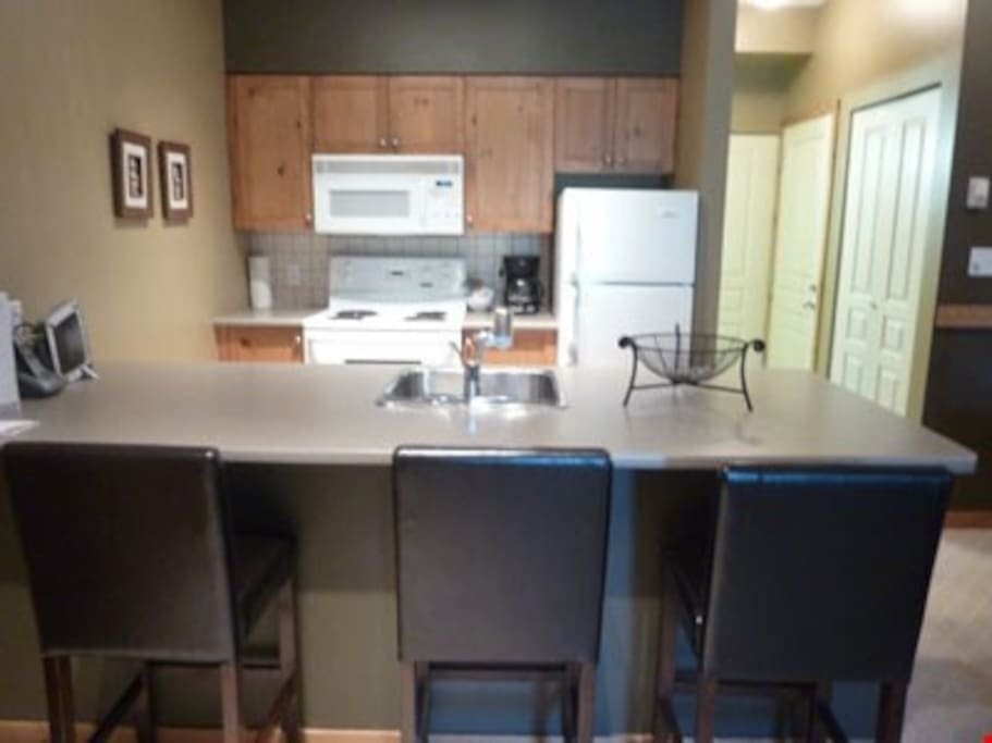 The full kitchen allows guests to prepare meals in the privacy of their own suite. They can enjoy them together at the breakfast bar, complete with stools.