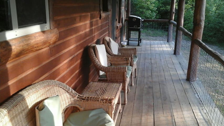 furnished covered porch with charcoal grill