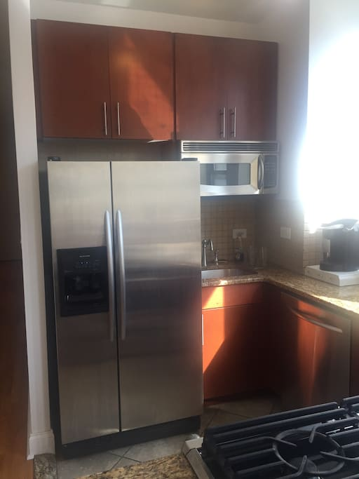 Kitchen with stainless steal new appliances (Dishwasher, refrigerator with filtered water, stove, oven, microwave )